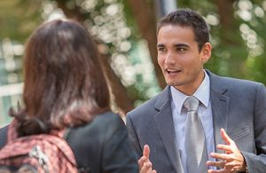 UF Online image of Business Administration students networking outdoors