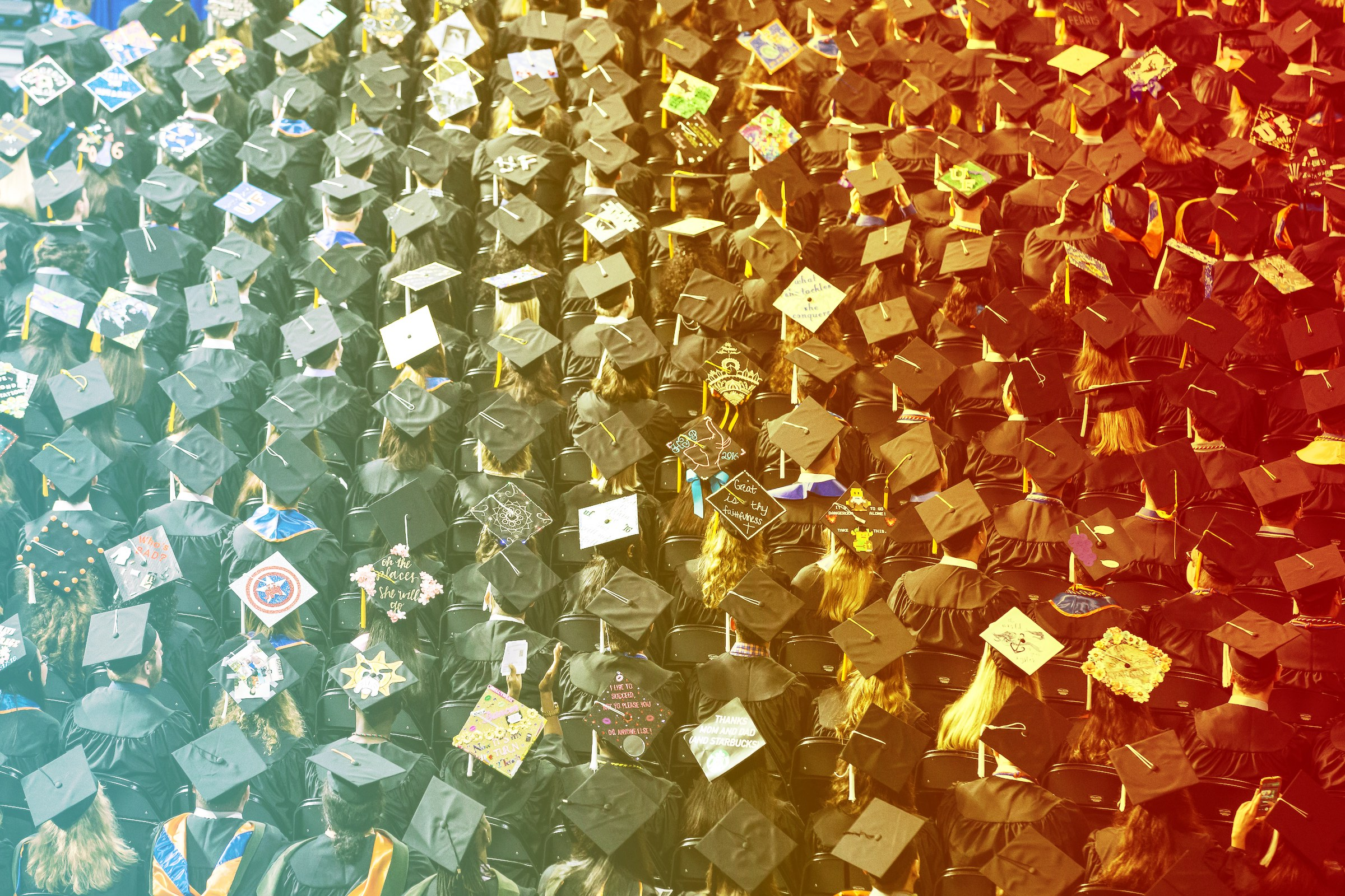 UF Online image of large group of graduates in cap and gown during ...