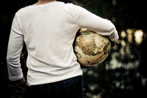 UF Online image of a person holding an antique globe
