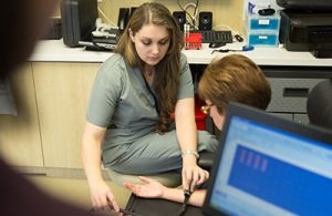 UF Online image of Nursing student taking pulse in clinicals