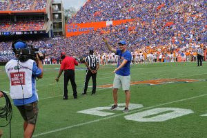 UF Online image of Sports Management major and My First Chomp in The Swamp contest winner Jackson Kewitsch giving a Gator chomp in Ben Hill Griffin Stadium
